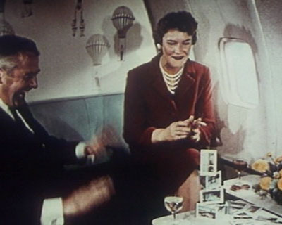 1950s Building a house of cards in the First Class lounge of a Pan Am Boeing 707.