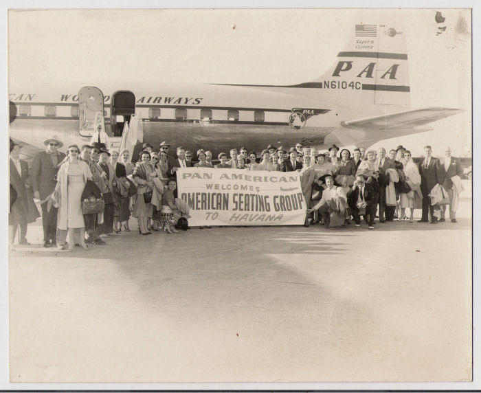 1950s American Seating Group pose for a picture enroute to Havana on a Pan Am DC6 tail number N6104C.