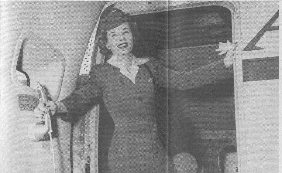 1950s A stewardess closing the door of a Boeing 377 Stratocruiser.