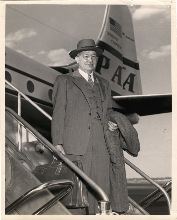 1950s Fred Soper a health official deplanes a Pan Am Clipper.