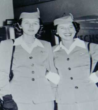 1950s Pan Am stewardess, Rosalie Tropper, and colleague pose for a picture at the airport.