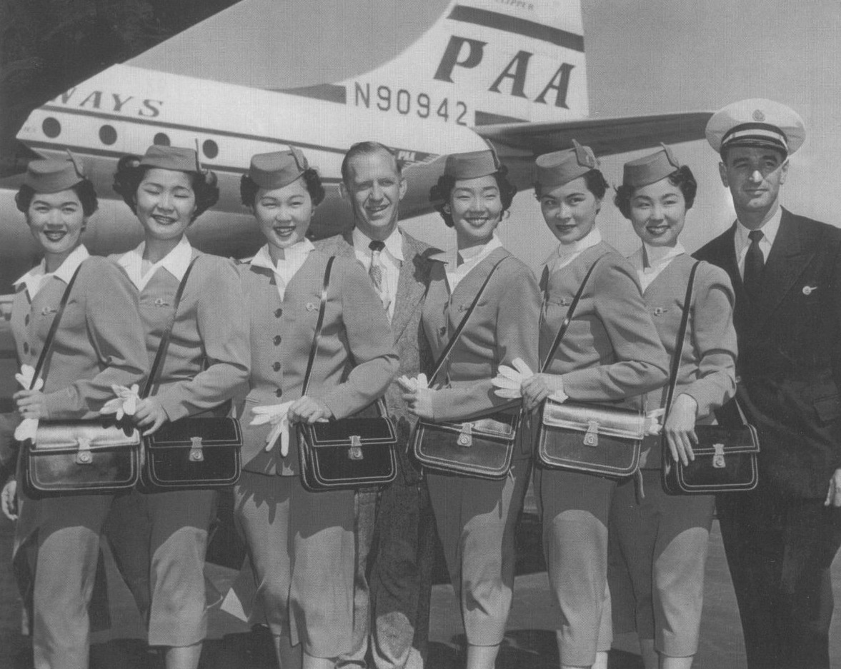 1950s Pan Am always looked to hire stewardesses with language skills.  Here a class of newly hired Japanese American woman pose by a Boeing  377 Stratocruiser.
