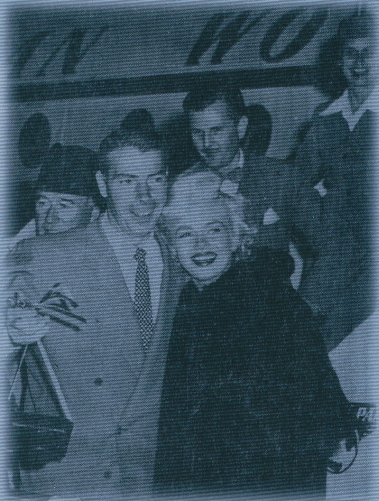 1950s Joe DeMaggio & Marilyn Monroe deplane after returning  from Japan.  Pan Am stewardess  Jane Gottschall is seen behind the couple.