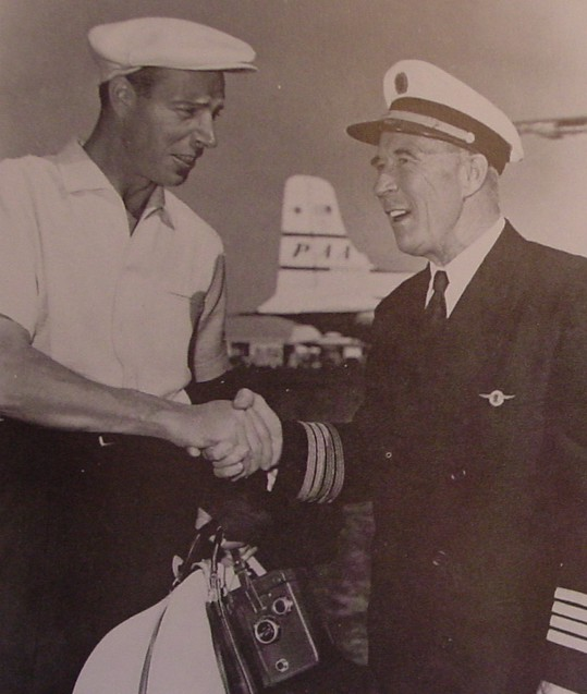 1950s Joe DiMaggio shaking hands with a  with Pan Am Captain.