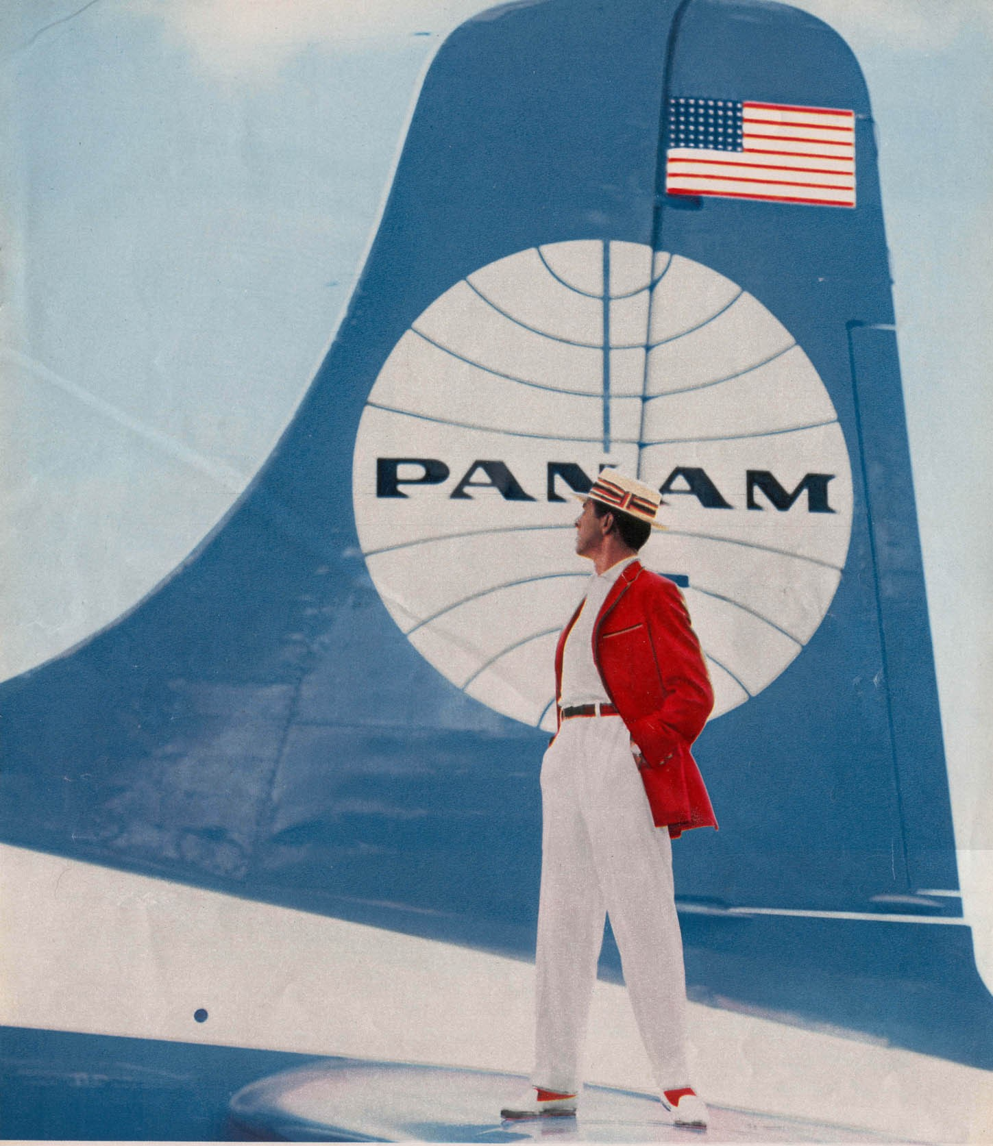 1950s Prior to adopting the blue ball with a white background Pan Am experimented with the reverse colors.  This picturew was taken from a men's clothing ad with the model standing on the tail of a Pan Am aircraft.