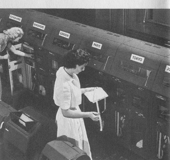 1950s A round the clock staff monitored Pan Am's telex system.