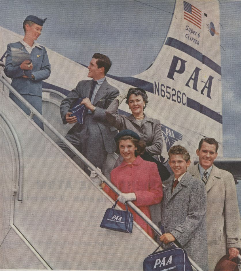 1950s  Family posing on steps of a Pan Am DC6 Clipper.