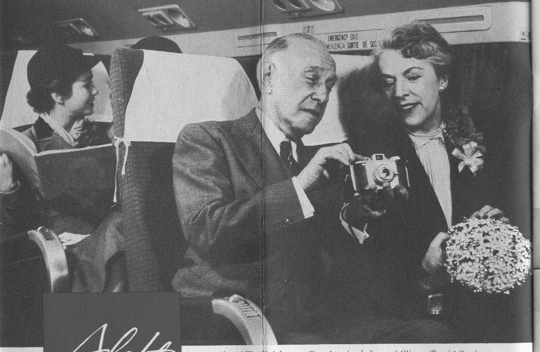 1950s A couple enjoy a happy moment in economy seats aboard a Pan Am Clipper.