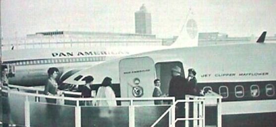 1950s Customers board  a Pan Am 707 from walkway at New York  JFK airport.