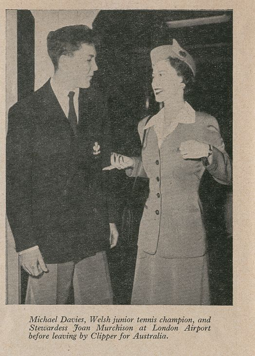 1952 A Pan Am stewardess poses with a tennis player from England.