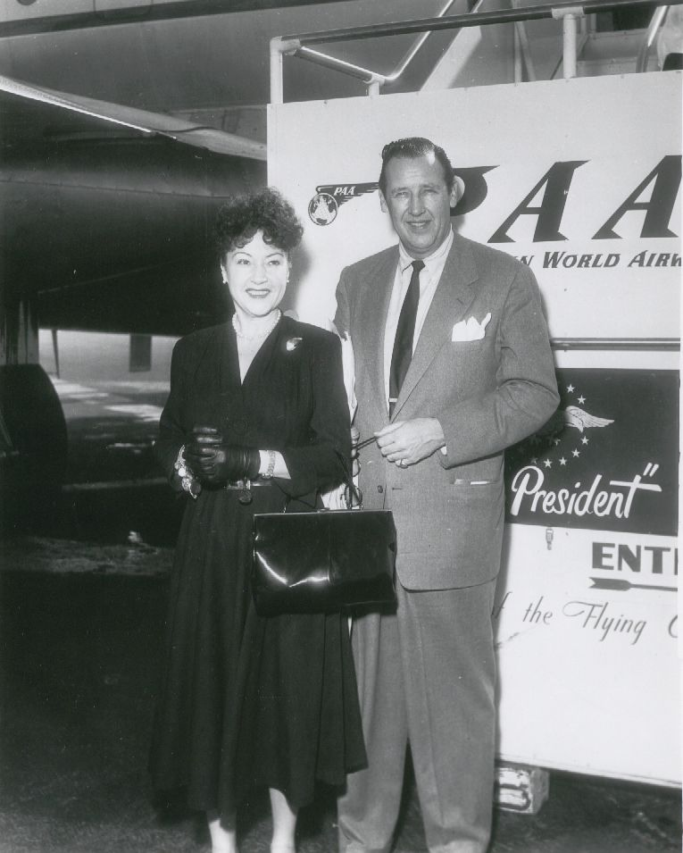 1954 Ethel Merman & husband Ed Six pose by a Pan Am Stratocruiser.