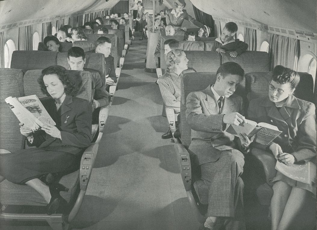 1956 A long cabin view of the Boeing 377 Stratocruiser.