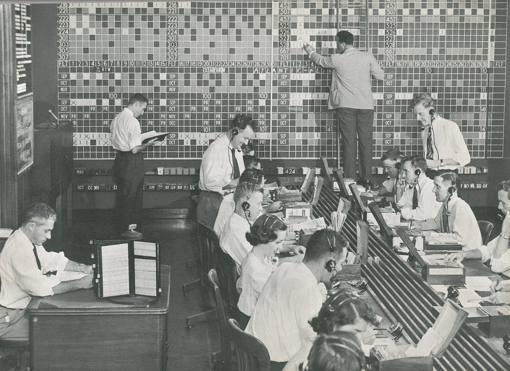 1956 Prior to computers Pan Am reservations agents sent request cards to a big board where booking levels were tracked.