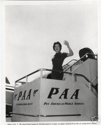1957 A customer waves goodbye as she boards a Pan Am Clipper.
