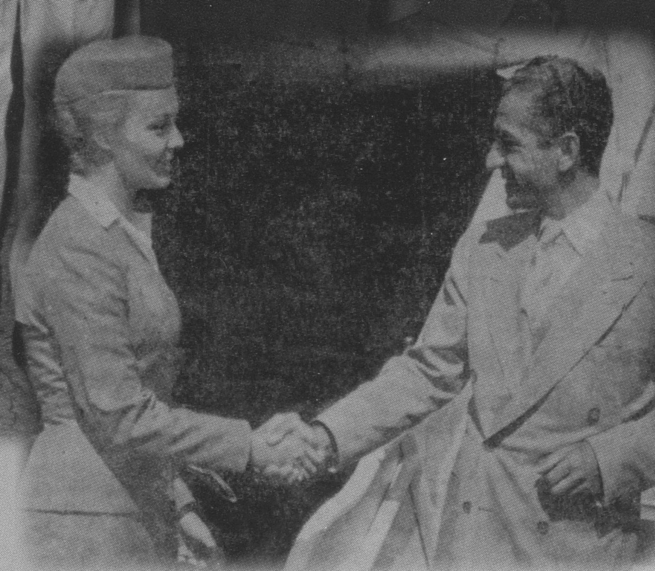 1958 Upon arrival in San Francisco from Honolulu Pan Am stewardess Ellen Forseth bids farewell to the last Shah of Iran.