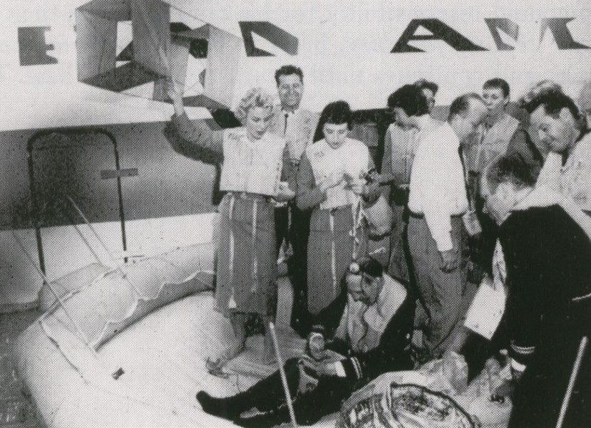 1959 Pilots & stewardesses practice sea ditching drills in a mock up at New York JFK airport.