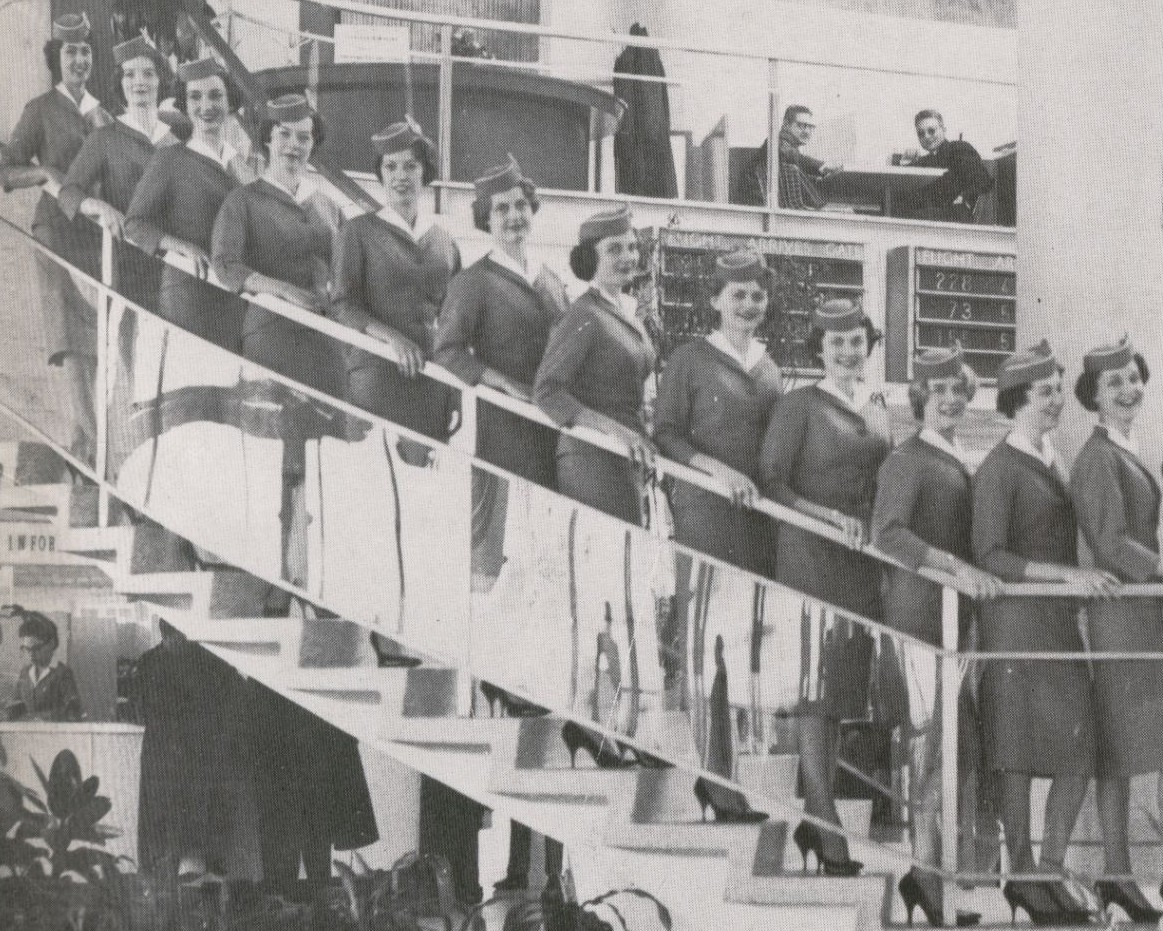 1959 A group of new Stewardesses pose on the steps of the Pan Am WorldPort at JFK Airport.
