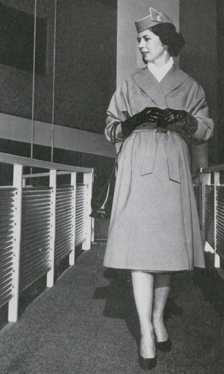 1959 A stewardess in her uniform coat on the jetway at the Pan Am WorldPort in New York.