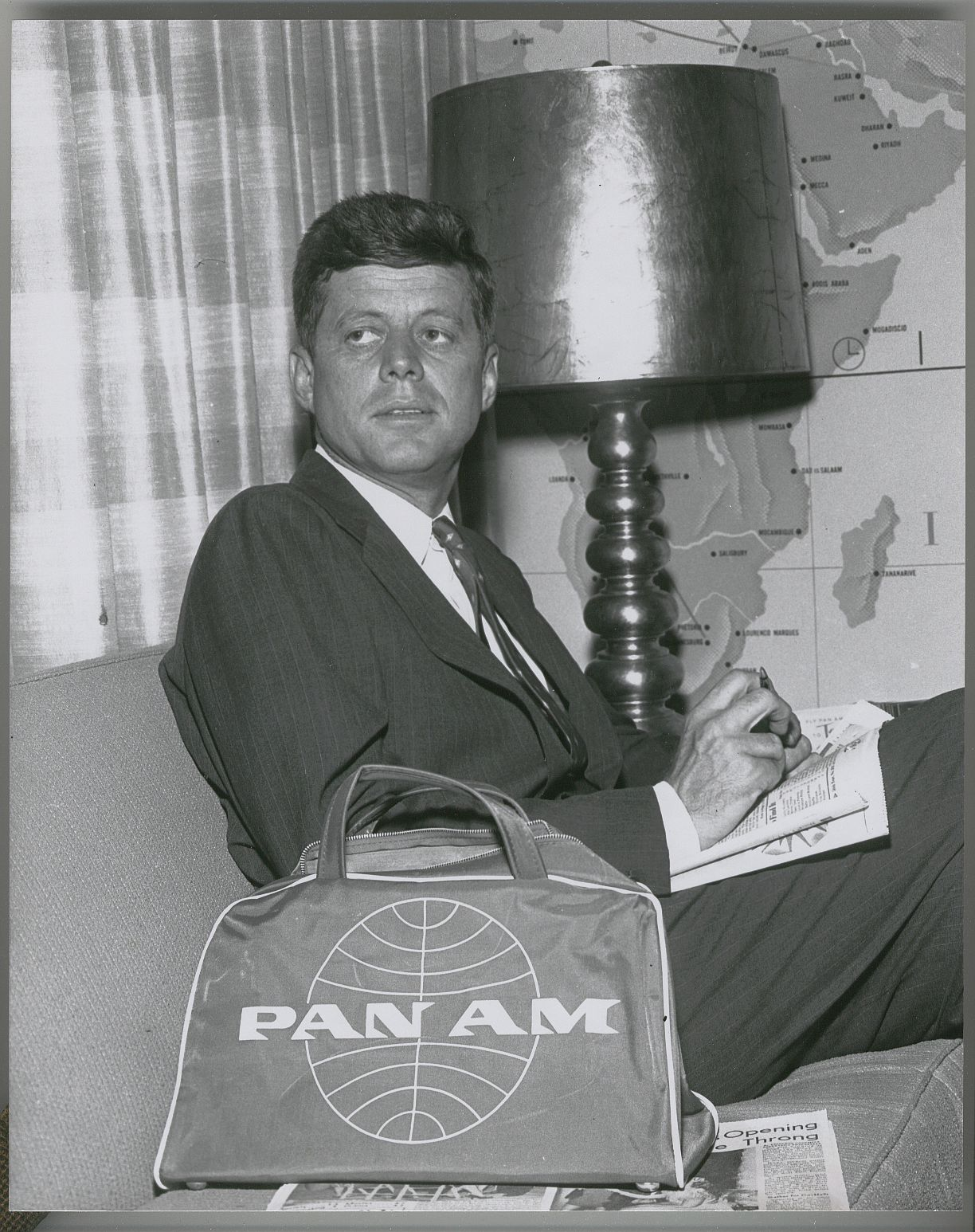 1959 Senator John F. Kennedy relaxes in a Pan Am Clipper Club prior to his flight.