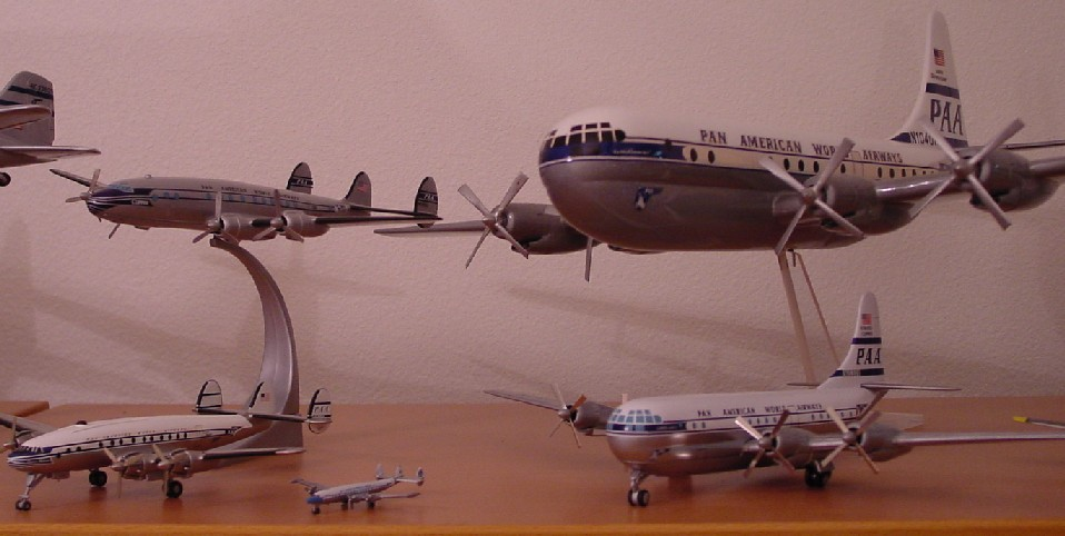 On the left are three examples of the Lockheed Constellation.  On the right two examples of the Boeing Stratocruiser.