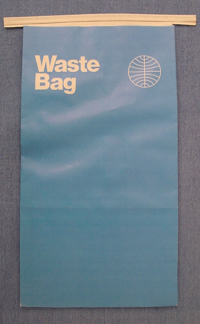 An air sick / in-flight waste bag from the early 1970s in the Helvetica style.