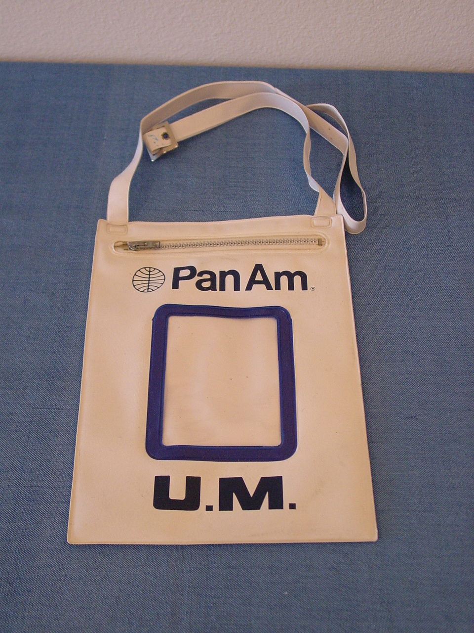 For young unaccompanied minors Pan Am had a pouch for them to wear so they could be easily identified by flight and ground crew.  This sameple in the Helvetica style dates from the early 1970s.