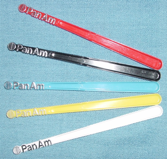 In the early 1970s Pan Am introduced cocktail sticks with the Helvetica logo.  Though the Arial logo was retired from most printed material by late 1974 the Arial cocktail sticks remained in use until the late 1980s.